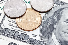 Coins over dollar Royalty Free Stock Photo