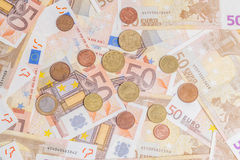 Coins over fifty notes Stock Images