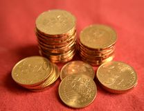 Coins over red Stock Image