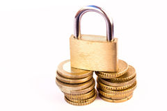 Coins and padlock Royalty Free Stock Photo
