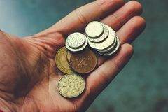 Coins in the palm of your hand. Coins, money on hands. Keep money in your hands. transfer coins, give loans money, show coins, offer iron money stock photography