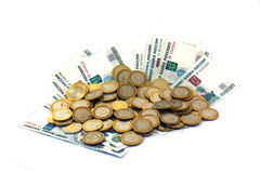 Coins on paper money. Rubles, isolated Royalty Free Stock Photography