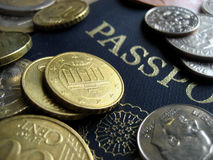 Coins and Passport Royalty Free Stock Photography
