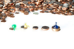 Coins and Pawns Royalty Free Stock Image