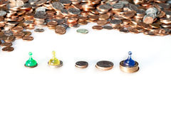 Coins and Pawns Stock Photos