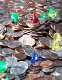 Coins and Pawns Royalty Free Stock Photos