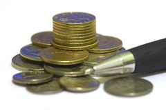 Coins and pen Royalty Free Stock Photo