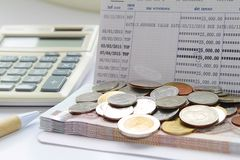 Coins, Pen And Calculator On Savings Account Passbook Stock Photography
