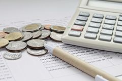 Coins, Pen And Calculator On Savings Account Passbook Royalty Free Stock  Photos
