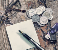 Coins and pen, retro Stock Image