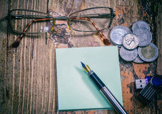 Coins and pen, retro Royalty Free Stock Image