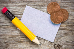 Coins with pencil and  paper card Royalty Free Stock Photos