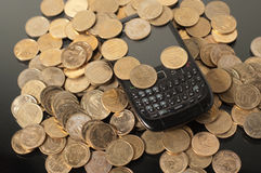 Coins and phone Stock Image