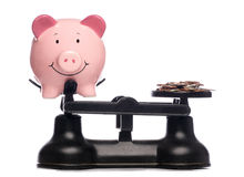 Coins and piggy bank royalty free stock image