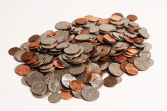 Coins pile. Pile of United States coins on a white background Royalty Free Stock Images