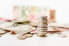 Coins pile and money Stock Images