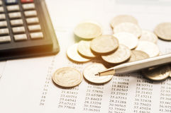 Coins, pile of money on summary report Stock Image