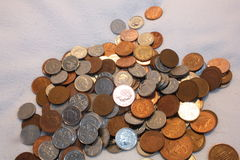 Coins. A pile of random British coins on a white background Stock Photos