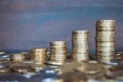 Rising coins. Coins piled up displaying a growing chart stock images