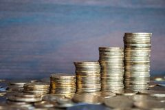 Rising coins. Coins piled up displaying a growing chart stock photography
