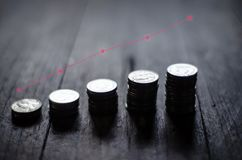 Coins placed in rows stock images