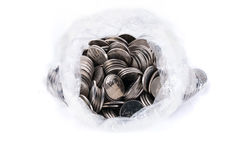Coins in plastic bag isolated on white Royalty Free Stock Photography