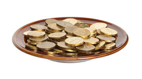 Coins on a plate. Royalty Free Stock Photos