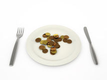Coins in a plate Royalty Free Stock Images