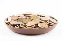 Coins on the plate Stock Photo