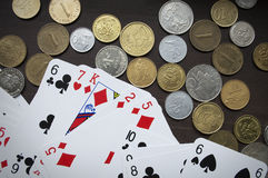 Coins and playing cards top view Royalty Free Stock Images