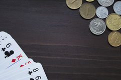 Coins and playing cards topview background Stock Photography