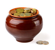 Coins in pot stock image