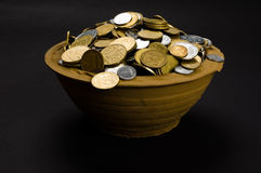 Coins in the pot Stock Images