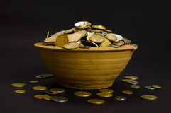 Coins in the pot and near Stock Image