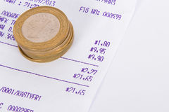 Coins and Receipt Royalty Free Stock Image