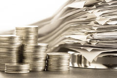 Coins and receipts Stock Images