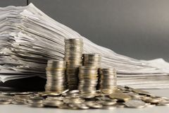 Coins and receipts Stock Photo