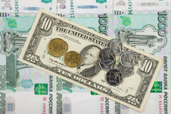 Coins ruble and the euro are on bill of ten dollars which lies on a pile of thousand-Russian banknotes. Coins ruble and the euro are on the bill of ten dollars Royalty Free Stock Photography