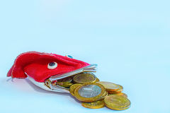 Coins Russian 10 roubles fall out wallet-fish. Coins Russian 10 roubles fall out of the wallet-fish Royalty Free Stock Images