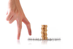 Coins, safekeeping concept. Coins with thumb tacks and a hand, safekeeping concept Stock Images
