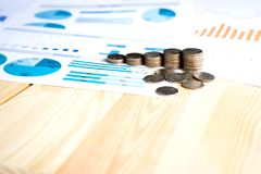 Coins, Savings, Chart Analyze. On the table Stock Photography