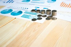 Coins, Savings, Chart Analyze. On the table Royalty Free Stock Photography