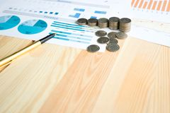 Coins, Savings, Chart Analyze. On the table Stock Images