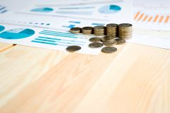 Coins, Savings, Chart Analyze. On the table Royalty Free Stock Photo
