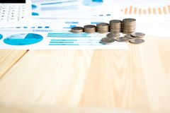 Coins, Savings, Chart Analyze. On the table Stock Image