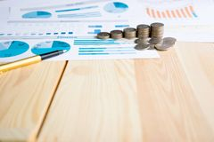Coins, Savings, Chart Analyze. On the table Royalty Free Stock Images