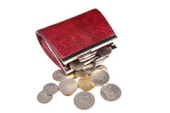Coins scattered out from red purse Royalty Free Stock Photos