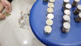 The coins are set in Thai Baht. Five baht and ten baht, one set as one hundred baht Stock Photography