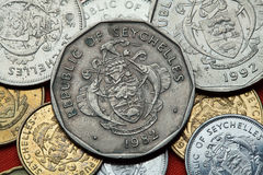 Coins of the Seychelles. Coat of arms of the Seychelles depicted in the Seychellois rupee coins Royalty Free Stock Image