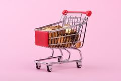 Coins in shopping cart royalty free stock photo